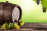 Wine keg on wood with blur green background