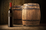 wine bottle and wooden barrel