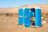 Man sitting in the Toilet in the middle of the desert - Death Va